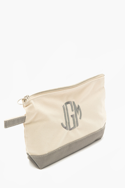 gray monogrammed canvas make-up bag